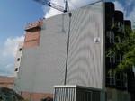 Impermeabilización de fachada medianera. Tabique pluvial con placa blanca.