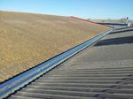 Sustitución de canal de desagüe en cubierta inclinada.